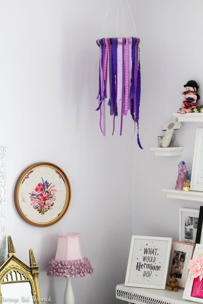 Learn how to make a DIY ribbon chandelier for DIY home decor or DIY party decor!  This simple project adds a fun touch to any room or event!  #kidsroomdecor #DIYhomedecor #homedecorcrafts #partydecor