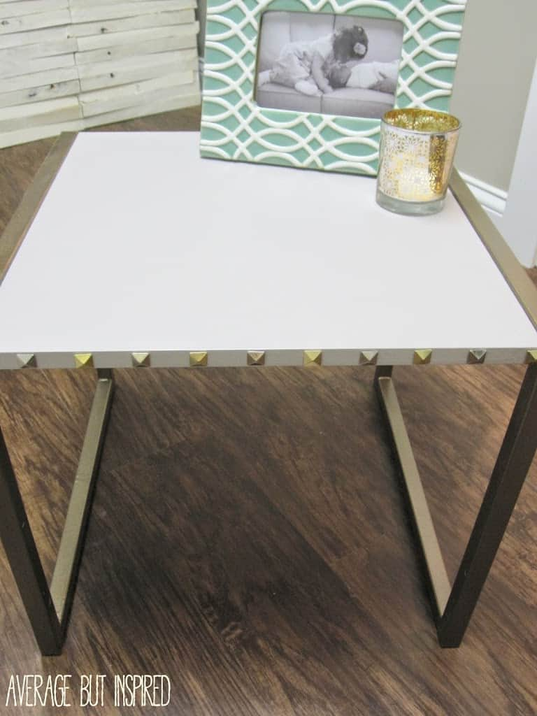 Embellish a table with thumbtacks or pushpins used as nailheads