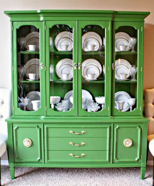 This china cabinet from Dimples & Tangles is a beautiful example of how to organize a china cabinet.