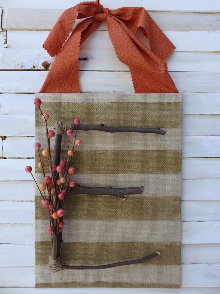 Fall door decor made with branches and berries. Average But Inspired