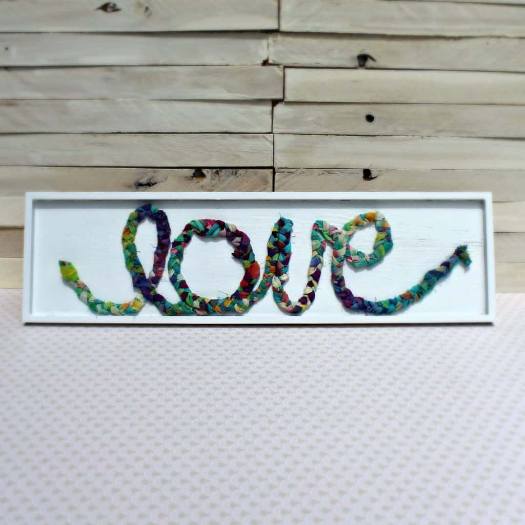 It's super easy to make an adorable braided fabric scrap sign! Get the full tutorial here.
