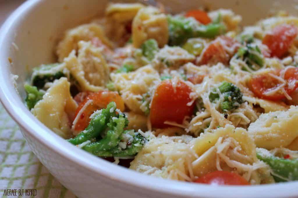 This cheesy tortellini pasta salad is PERFECT as a meal on a hot summer night, or as a side dish at any barbecue!  It's packed with tasty veggies, zesty flavoring, and lots of cheese!