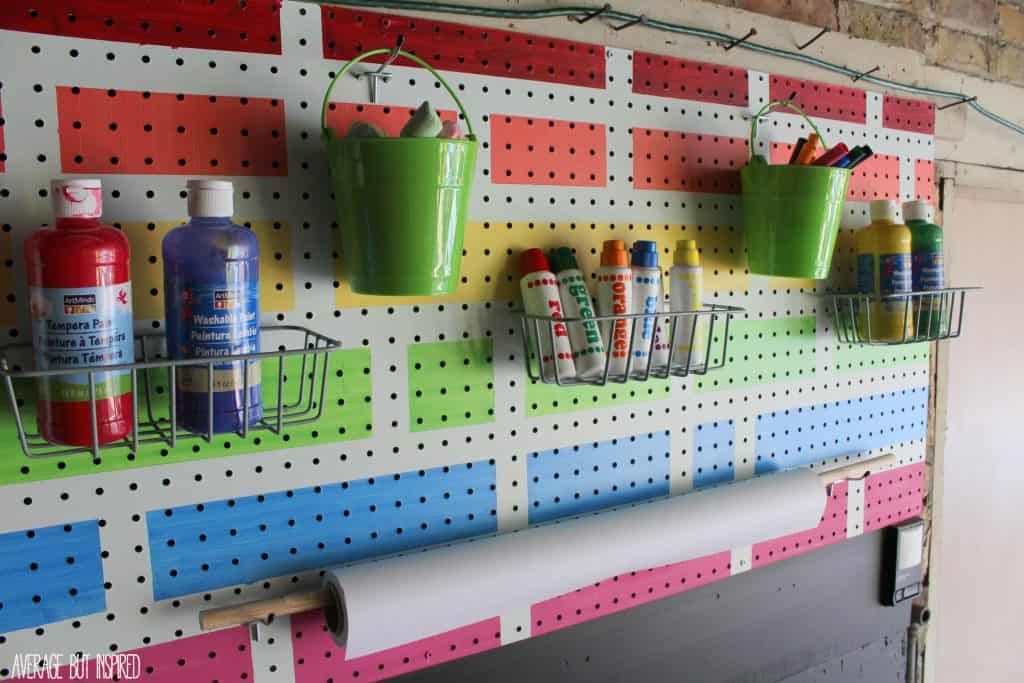 Turn an empty wall into a pegboard creation station for kids! Neatly store art supplies on pegboard up top, and create a chalkboard wall beneath for hours of fun!