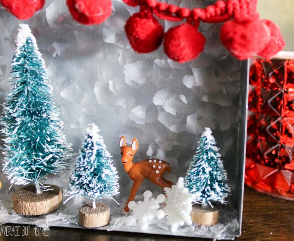 Bottle brush trees and mini plastic deer help make an adorable diorama for Christmas!
