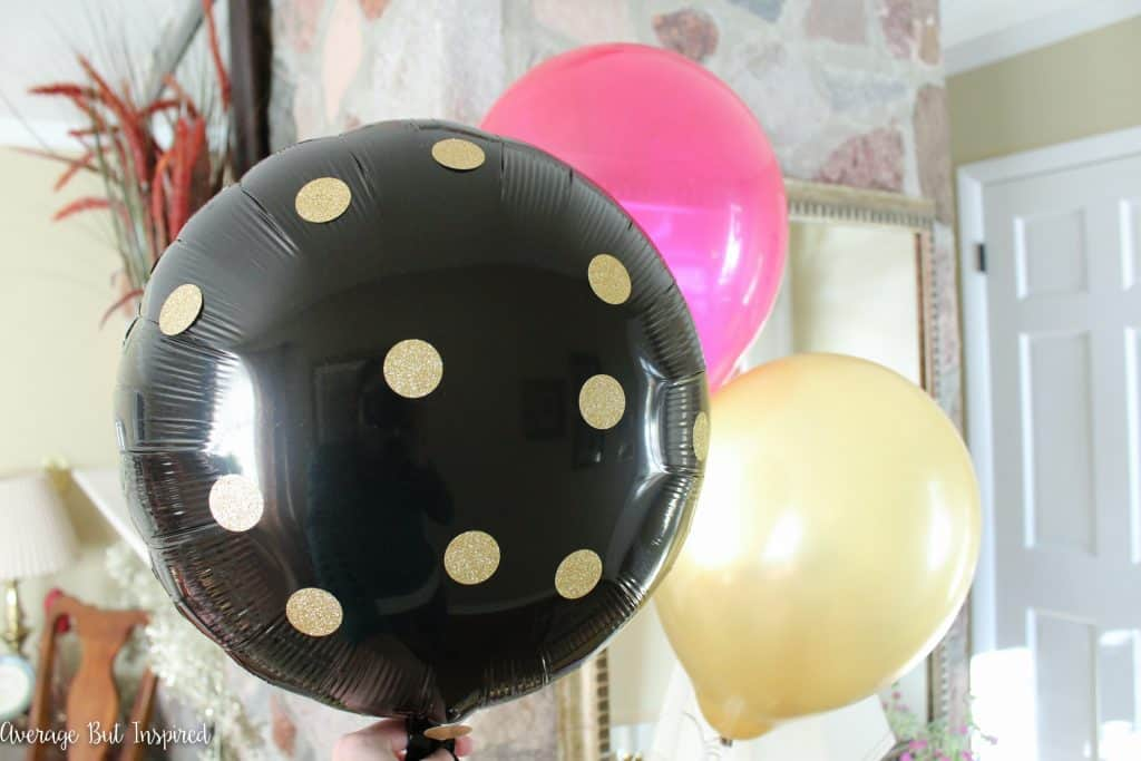 Adorable! Use gold envelope seal stickers as polka dots on a mylar balloon for a fun party decoration!