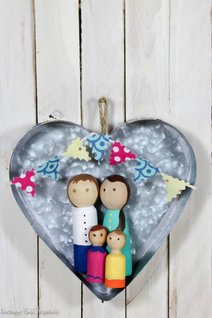 This is so cute! A DIY personalized peg doll family is a fun project! It makes a great addition to a gallery wall and is a perfect, thoughtful gift for any family!