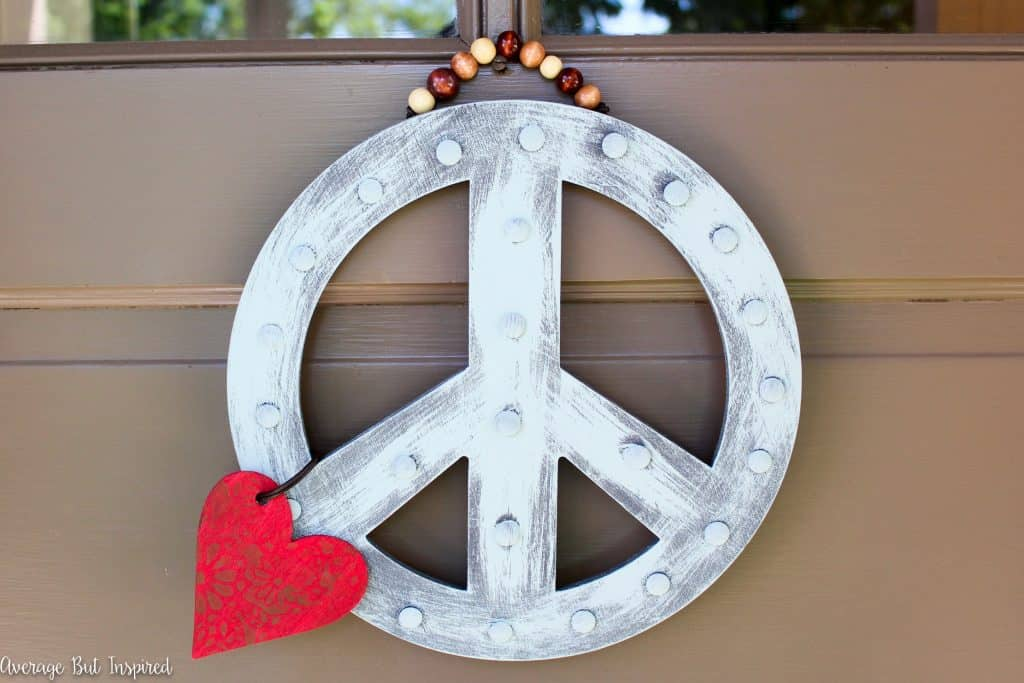 A DIY Peace Sign Wreath is a great way to greet visitors to your home! Get the full tutorial in this post.