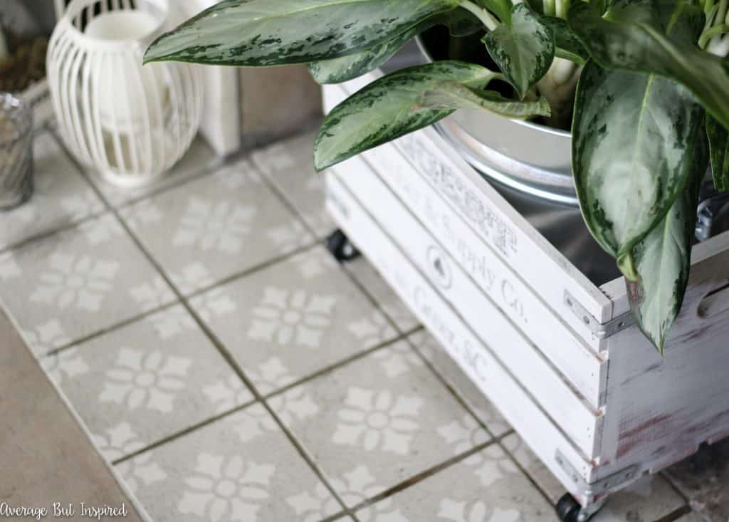 A vintage fireplace got a new look with stenciled tile. Get the full tutorial for painting and stenciling tile right in this post.
