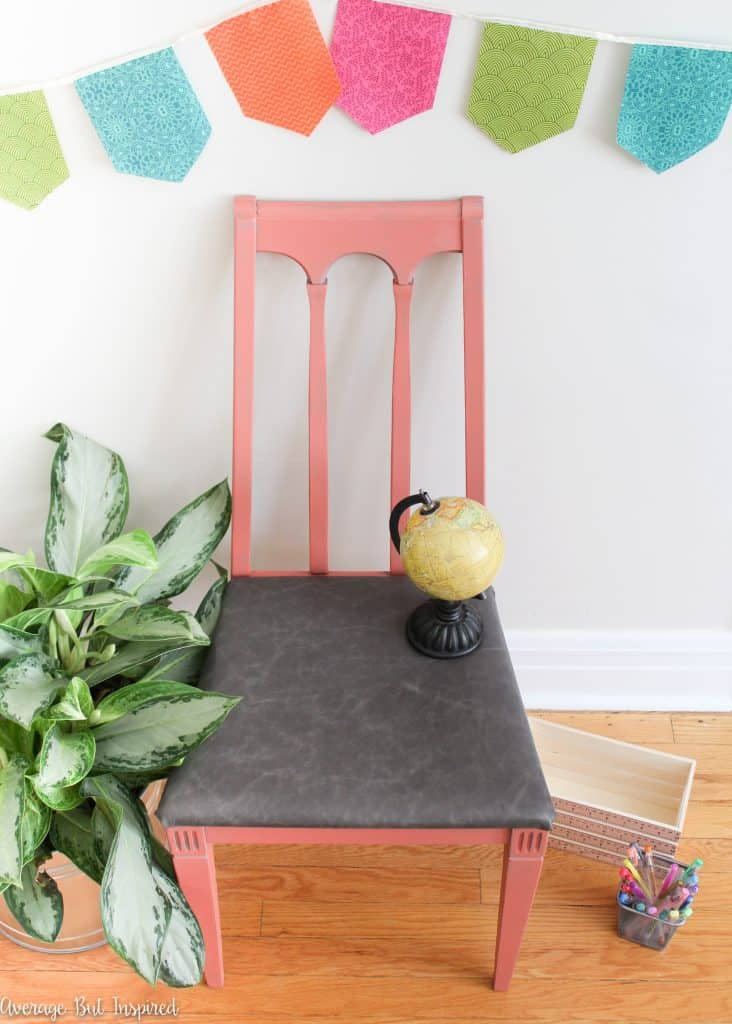 An ugly old chair gets new life with gorgeous paint and a reupholstered leather seat.