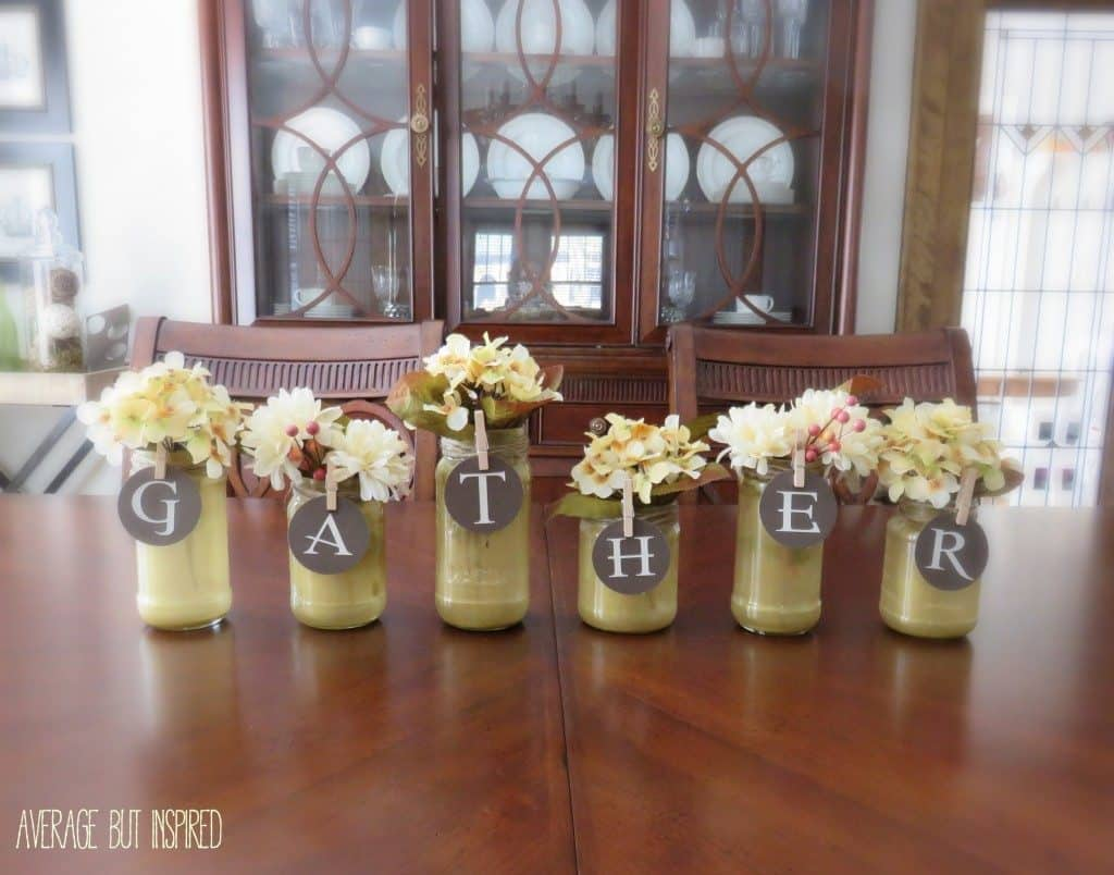 Glitter glaze glass jars with easily removable paper letters.
