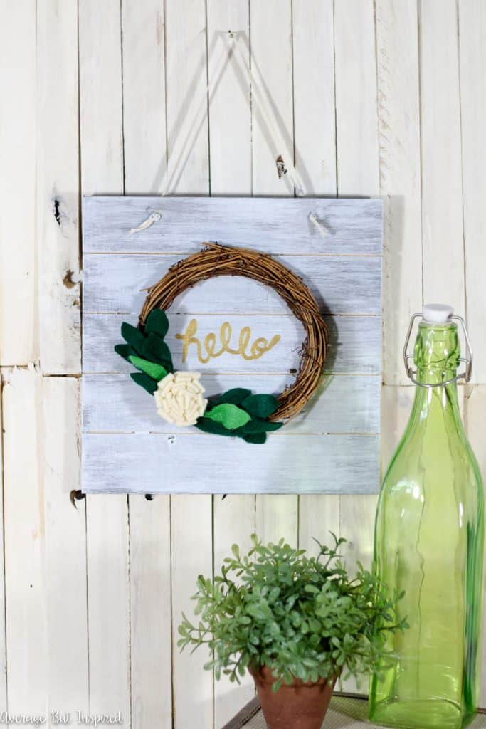 "Learn how to make a cute ""hello"" sign to greet guests! This is a great DIY gift idea or housewarming gift."