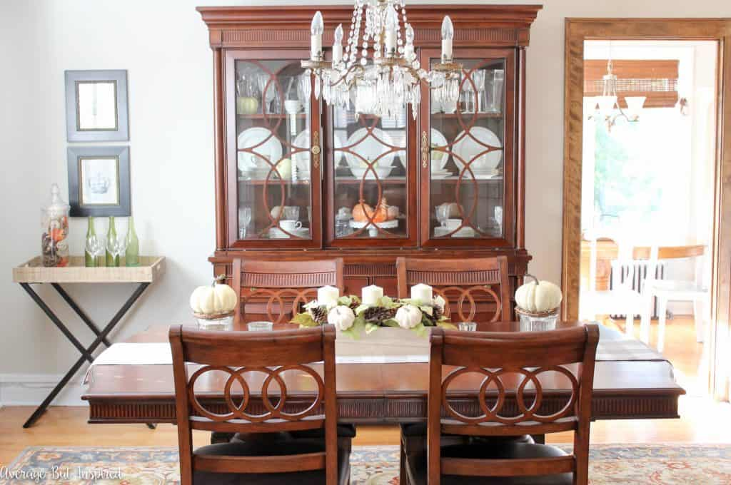 This dining room is decorated for fall and autumn with shades of the season and lots of neutral tones.