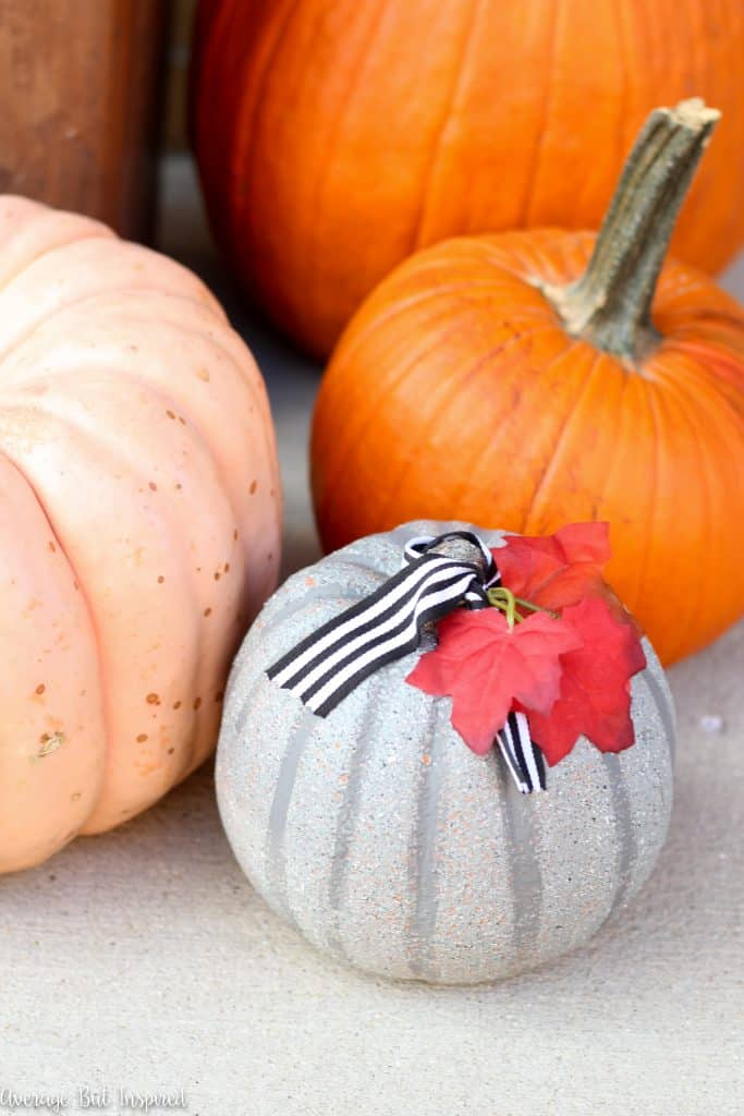 Faux concrete pumpkins are easy to make and a perfect pumpkin for your porch! Get the tutorial on how to make concrete look pumpkins in this post.