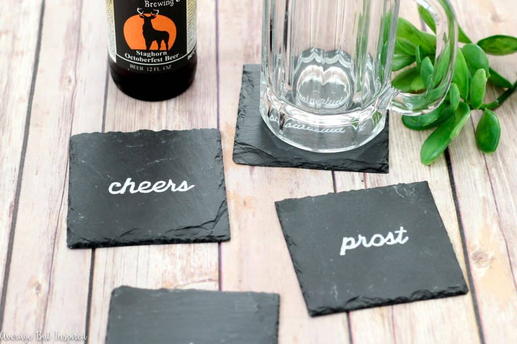 In just ten minutes you can make these DIY coasters! Learn how to customize slate coasters with ANY saying or image you want! These diy coasters are a perfect handmade gift for anyone on your list.