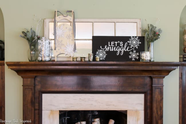 Such a great idea to create a pretty winter mantel after Christmas! This post shows you how to use items you may already have to decorate your mantel for winter.