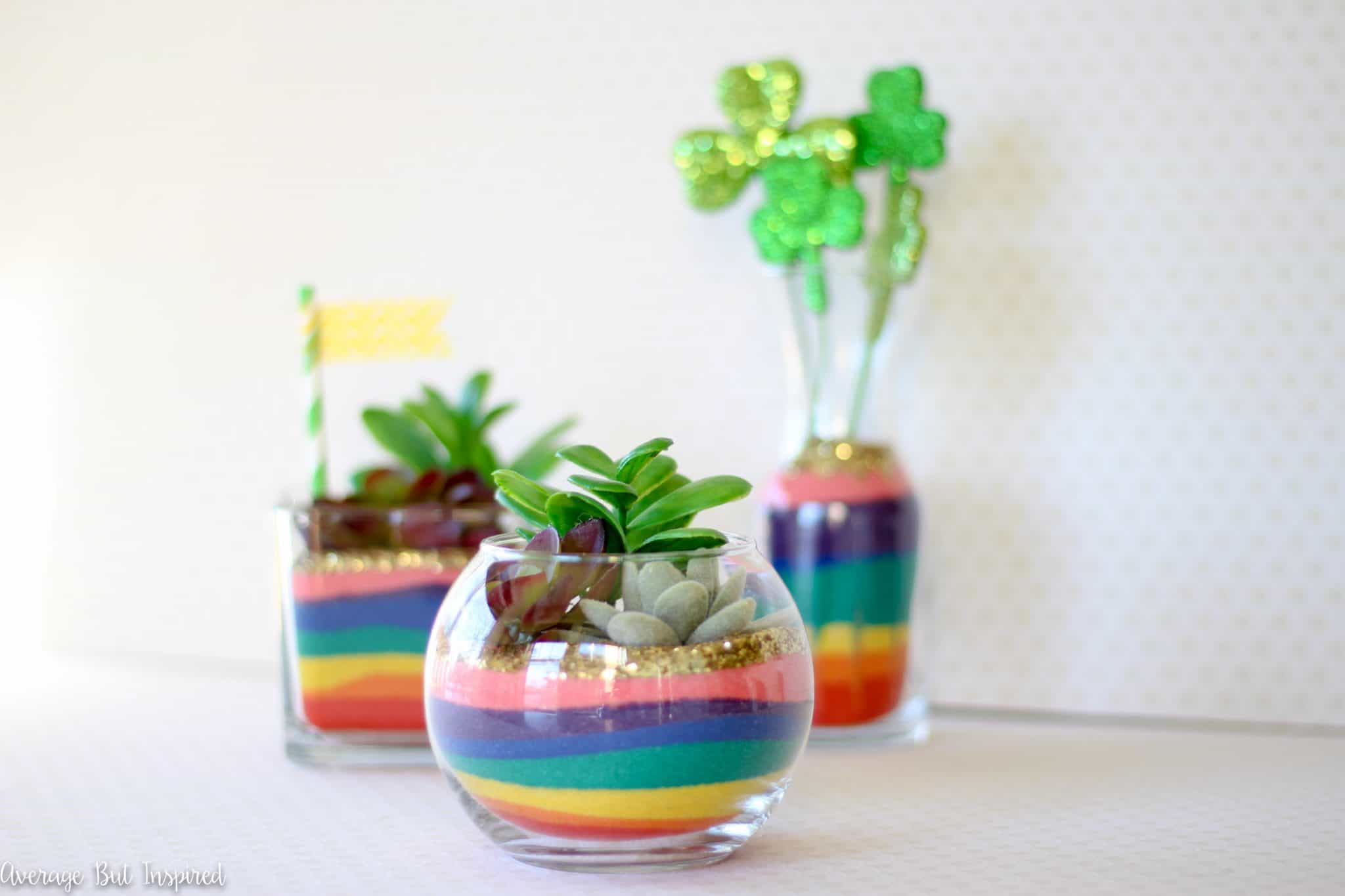 These Rainbow Sand Art Terrariums are sure to put a smile on anyone's face! Add a lot of color to glass vases with colored sand in rainbow hues! A perfect St. Patrick's Day craft for any age!