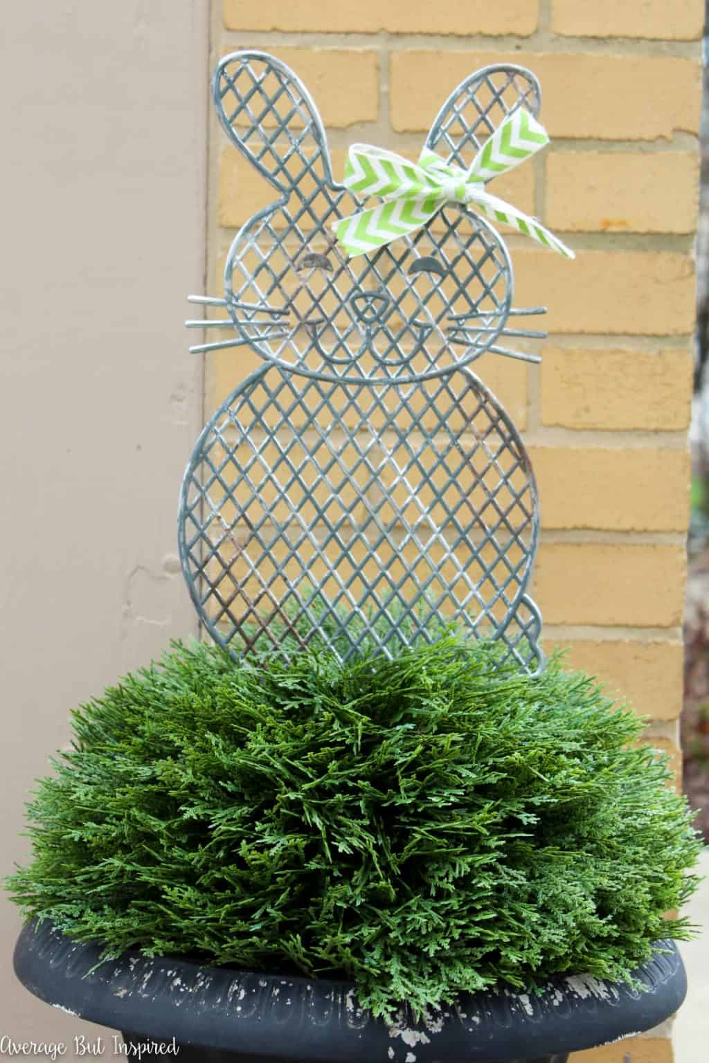 Give plastic dollar store planter stakes a beautiful makeover with a faux metal finish! Learn how to easily upgrade the look of these cute spring decorations in this post.