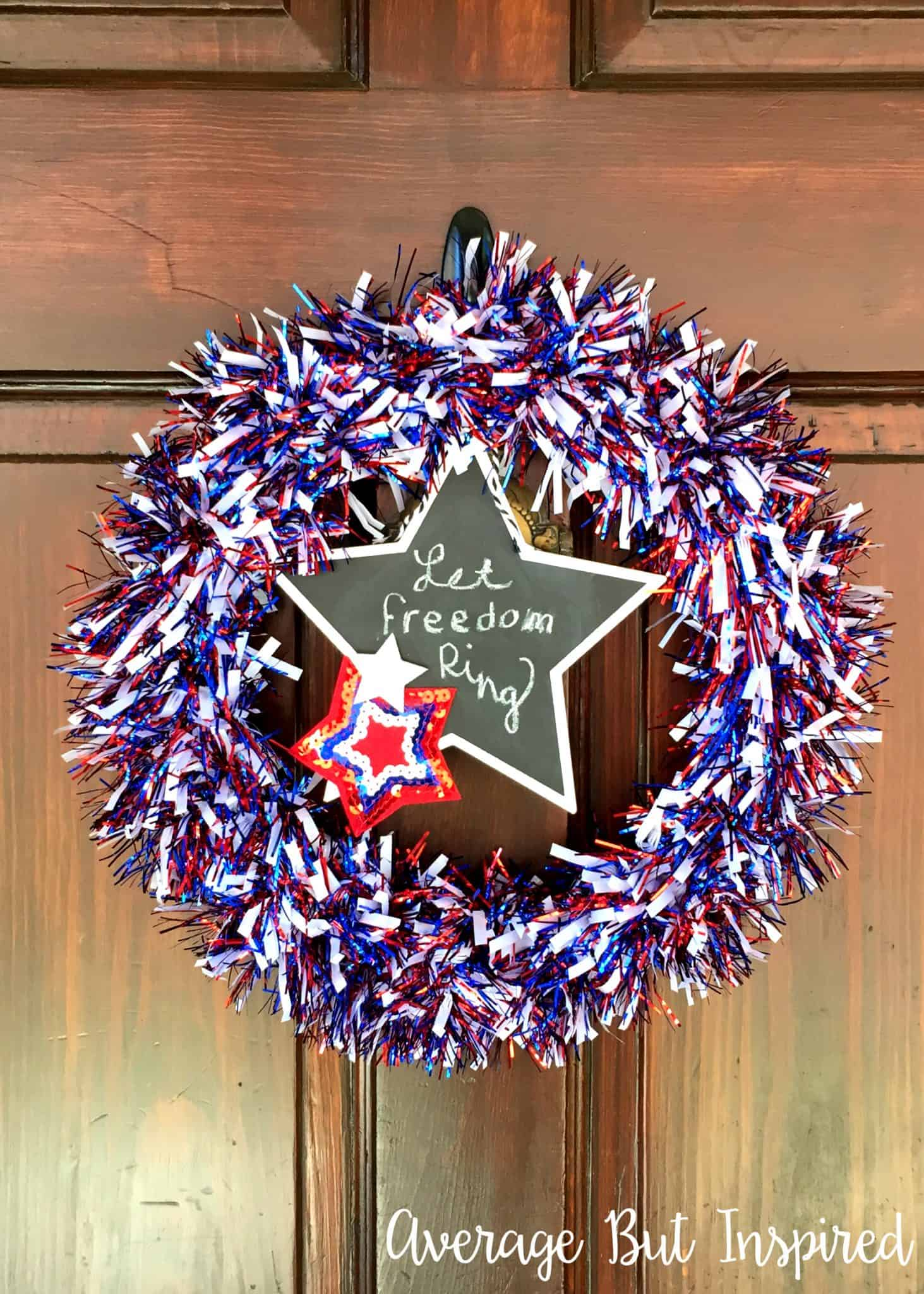 Make a DIY Fourth of July Wreath with supplies from Dollar Tree! This wreath cost $5 total to make! The tinsel garland adds a festive and sparkly touch for the Fourth of July.
