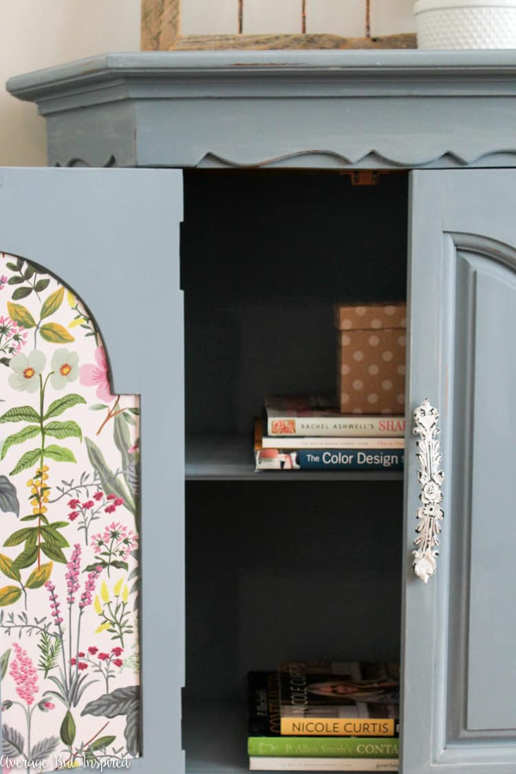 This dated console cabinet was given a stunning makeover with FAT Paint chalky style paint in Antique Wedgewood and white wax. Click through to see the before and after photos!