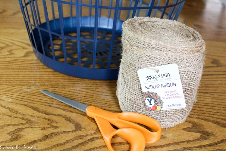 It's easy to transform a dollar store laundry basket into a pretty burlap basket! What a great burlap craft project!