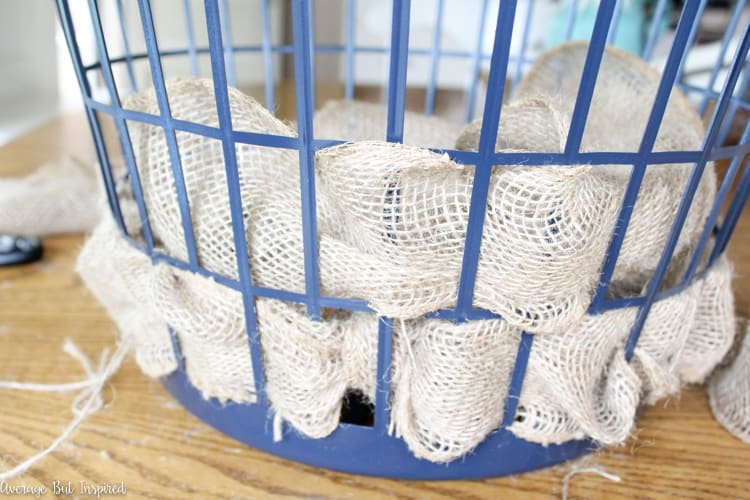 It's easy to transform a dollar store laundry basket into a pretty burlap basket! What a great burlap craft.