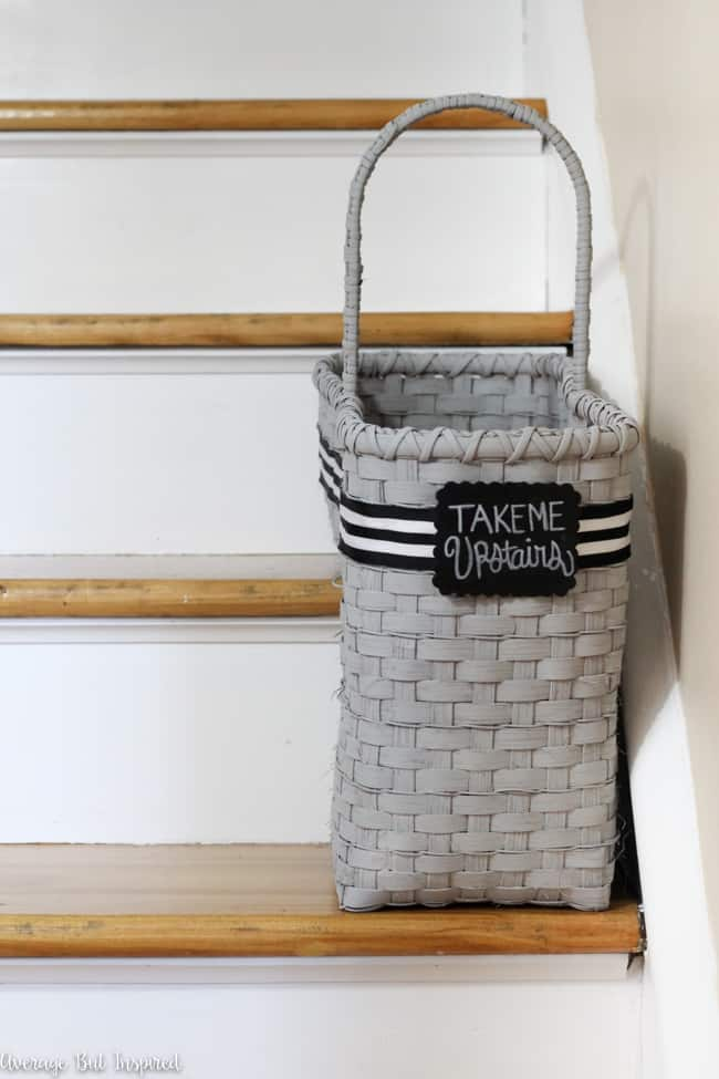 A dated staircase basket from the thrift store got a fresh new look with spray paint, ribbon, and a chalkboard tag.