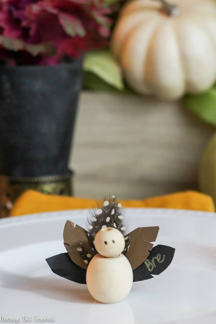 Make adorable Thanksgiving Turkey Place Cards with wooden beads for your Thanksgiving table this year! Learn how to make these DIY Thanksgiving place cards with this easy tutorial! #Thanksgiving #placecards #ThanksgivingTable