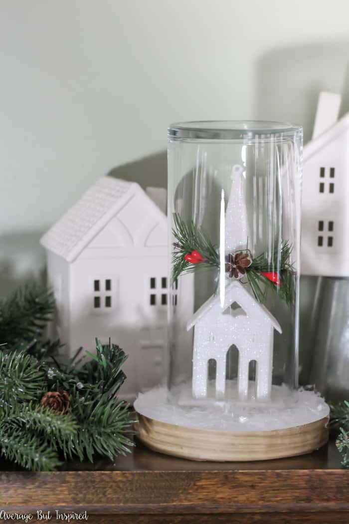 Transform a dollar store ornament and other supplies into a pretty Christmas Cloche for your DIY Christmas decor! #dollarstore #dollartree #Christmasdecor