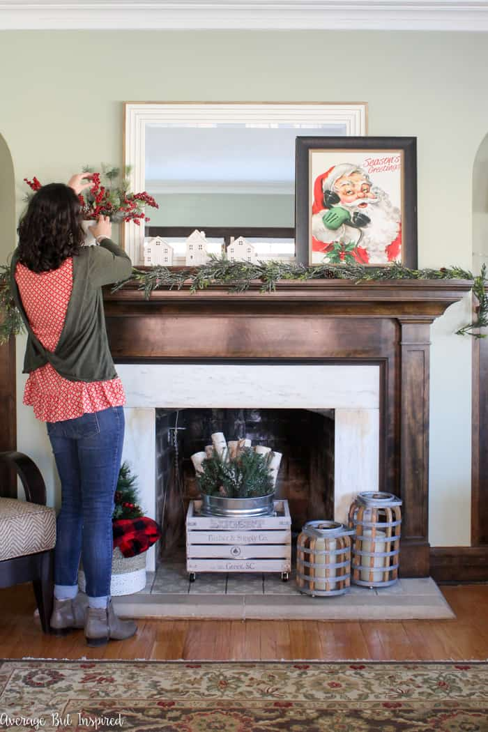 Get the classic Christmas look with traditional red and green decor! A classic Christmas mantel is so easy to put together!