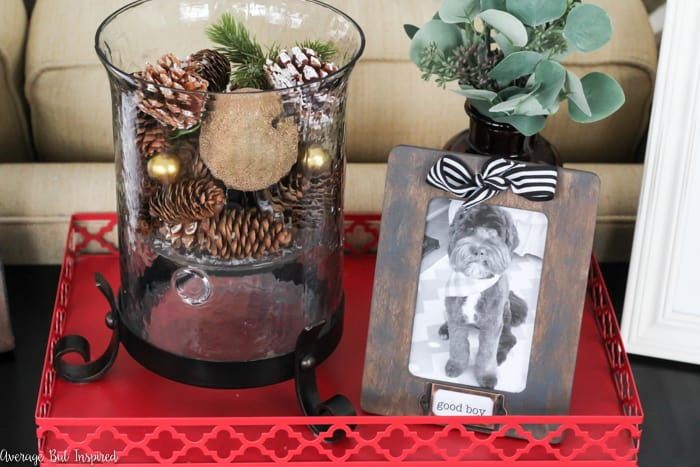Upgrade a simple wooden picture frame by turning it into a labeled picture frame! This project gives $1 frames a boutique look at a fraction of the price with metal label holders! #crafts #diypictureframe