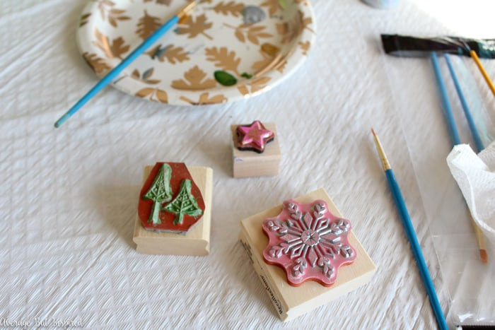 Tile samples can be turned into beautiful ornaments with this tutorial! These upcycled tile Christmas ornaments are so easy to make and fun for all ages! #upcycle #ChristmasCrafts #ChristmasOrnaments