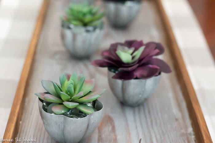 Thrift stores are full of mini Jello molds! Stock up and turn them into an adorable mini Jello mold planter that doubles as a votive holder centerpiece! This is such a versatile thrift store upcycle.
