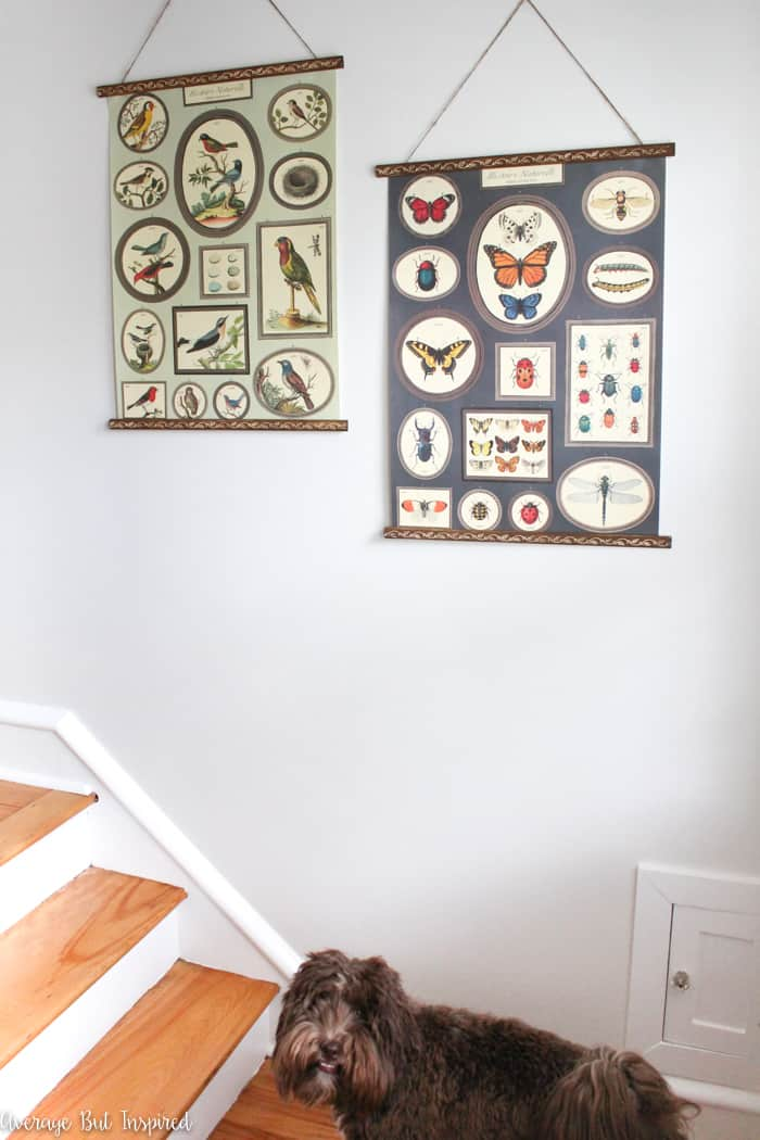 Looking for an easy and inexpensive way to display wall art or posters? I'll show you how to make the easiest DIY wall art hanger in this post! It's perfect for turning wrapping paper or posters into pretty pieces of hanging art for your home!