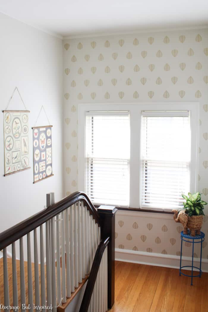 Make a big impact with no commitment! Learn how to apply wall decals for a faux wallpaper look. It's a low-cost project that adds the wallpaper look to your home, and it's easier than hanging wallpaper.