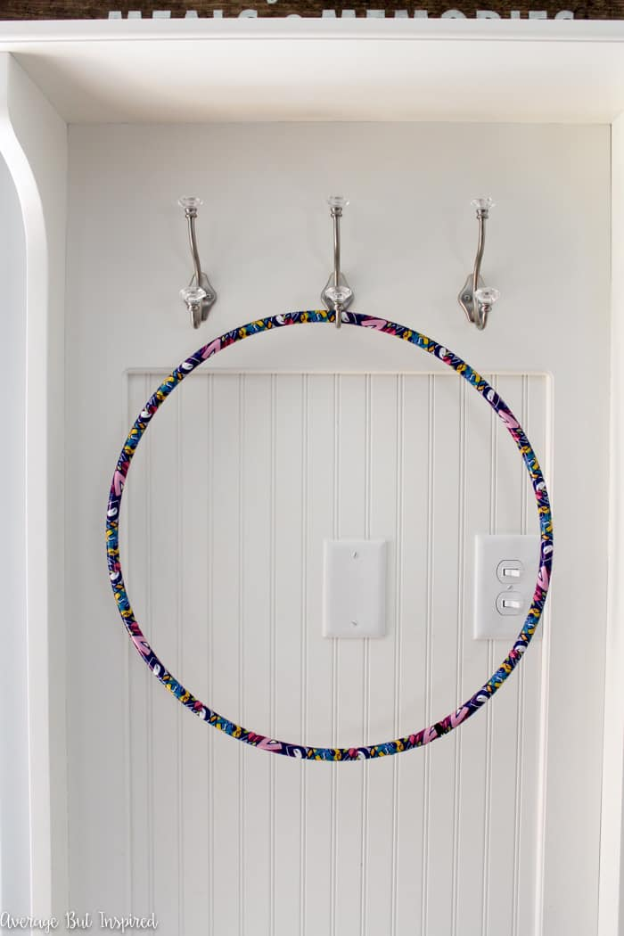 Add a pop of color to your patio with a pretty DIY Outdoor Hula Hoop Wreath! Click here for the tutorial on how to make a hula hoop wreath, and learn how to protect it for outdoor use.