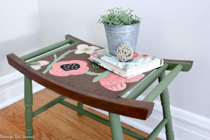 This Rifle Paper Co. inspired furniture makeover is so cute! Freehand painted flowers adorn the top of this chalk painted stool to give it a charming new look.