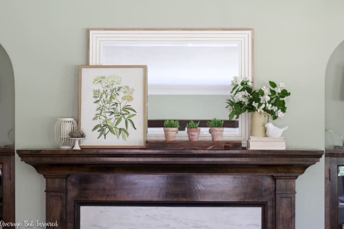 Update your living room with a simple summer mantel and decor updates. See how this blogger freshened her home for summer with inexpensive items and fresh greenery.