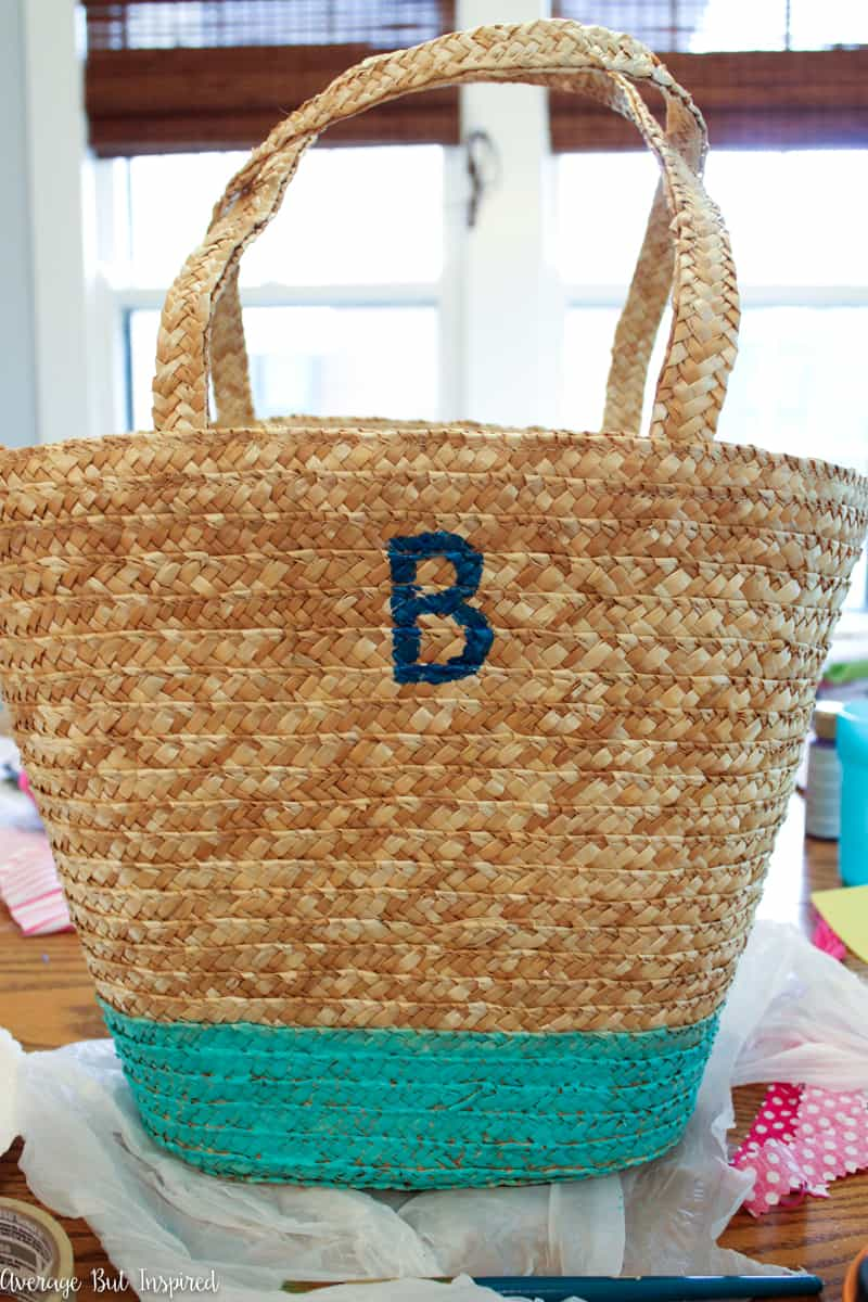 Grab a plain straw bag and customize it with paint and a DIY fabric tassel! It's so easy to get this trendy straw bag look for summer without spending a fortune. Learn how in this post!