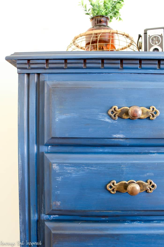 So pretty! Learn to create a denim faux finish for furniture with this furniture painting technique post! Layered chalk paint and dark wax create this moody blue denim faux finish look.