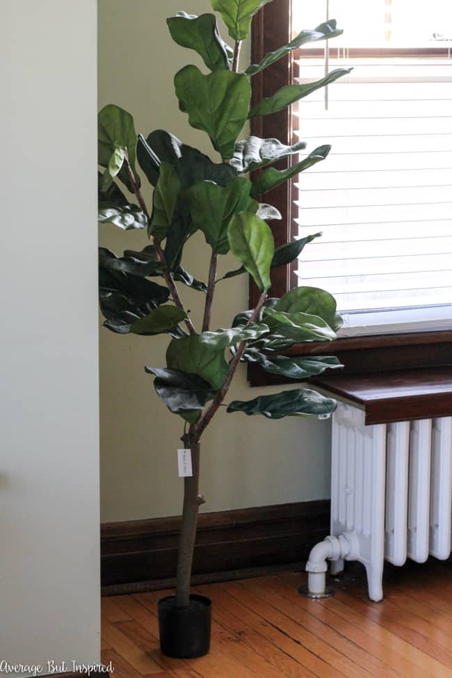 This fake fiddle leaf fig tree looks much more realistic with the addition of some dollar store supplies. Read this post to see how to make a fake fiddle leaf fig tree look real.