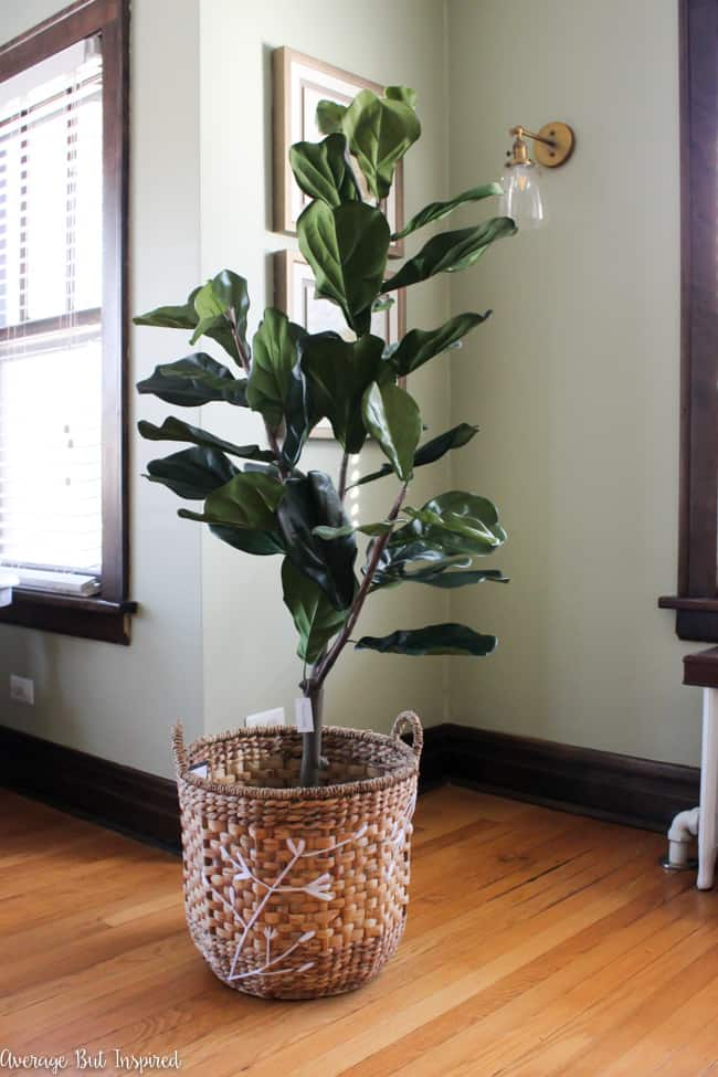 A gorgeous embroidered basket is one item that helps make this fake fiddle leaf fig tree look real.