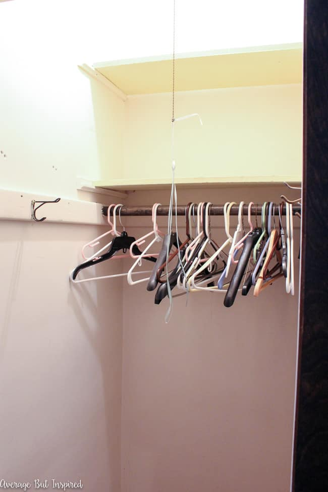 The first step of a coat closet organization makeover is to clear everything out.