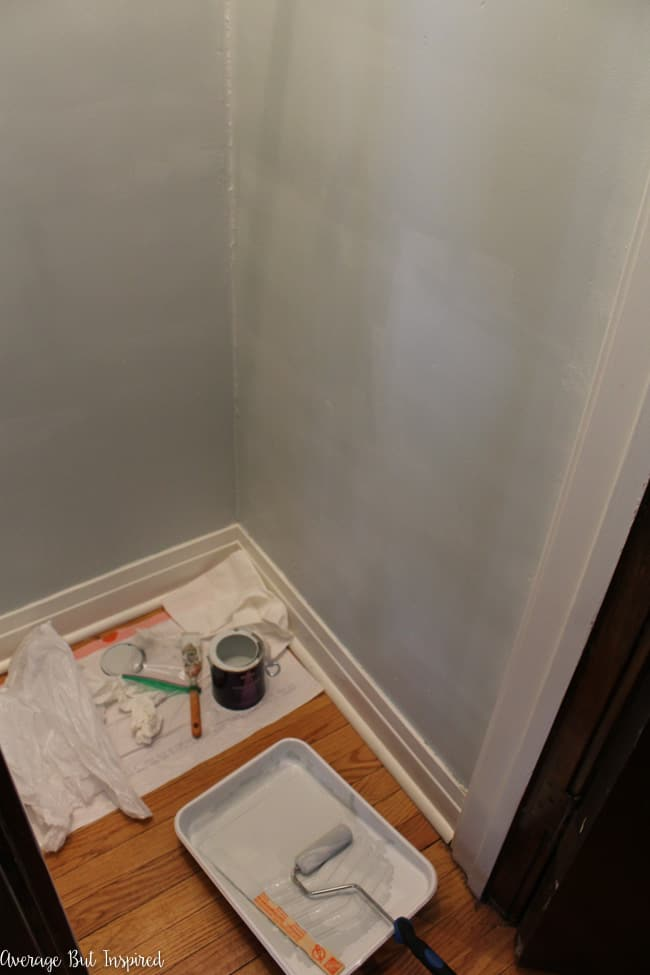 The second step of a coat closet organization makeover is to paint the closet.