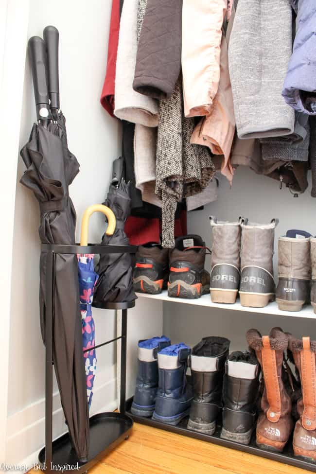 A narrow umbrella holder and functional boot rack help this coat closet organization makeover succeed.