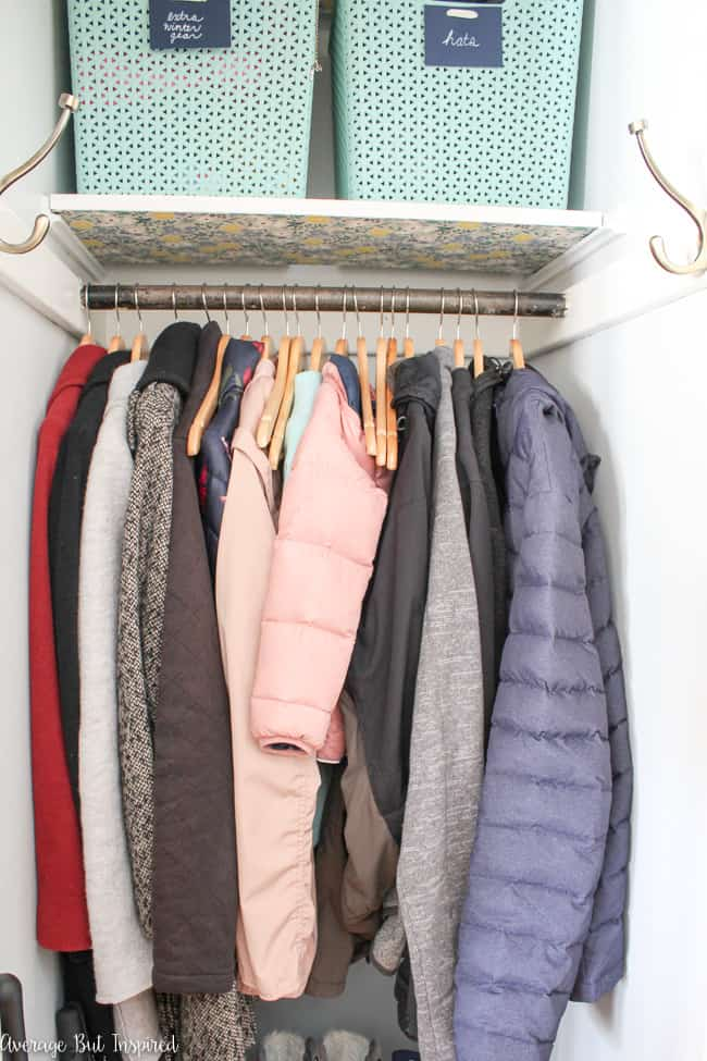Love this coat closet organization makeover! Learn how to make a small coat closet function for you!