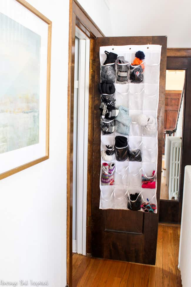 A clear shoe hanger functions perfectly in a coat closet to keep items like scarves, hats, and gloves organized.