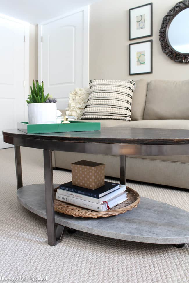Struggling to figure out how to pick the right coffee table for your space? This post will help! Learn basic measurements to take into consideration, style issues, and other factors you should consider when purchasing a new coffee table. This oval coffee table with two tiers is wonderful for a small living space.