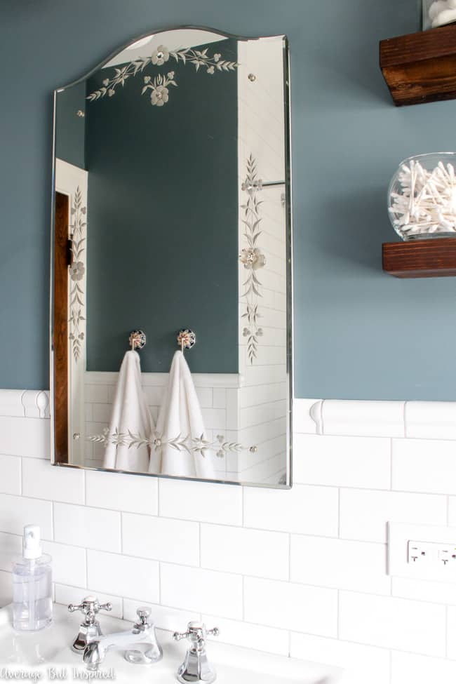 This original 1927 mirrored medicine cabinet is one of the features saved in this bathroom renovation.