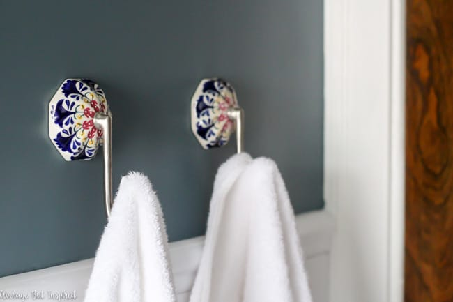 Painted ceramic towel hooks look gorgeous paired with Charlotte Slate walls.