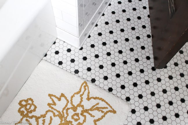 Black and white hexagon mosaic tile with light gray grout looks vintage and fresh at the same time.